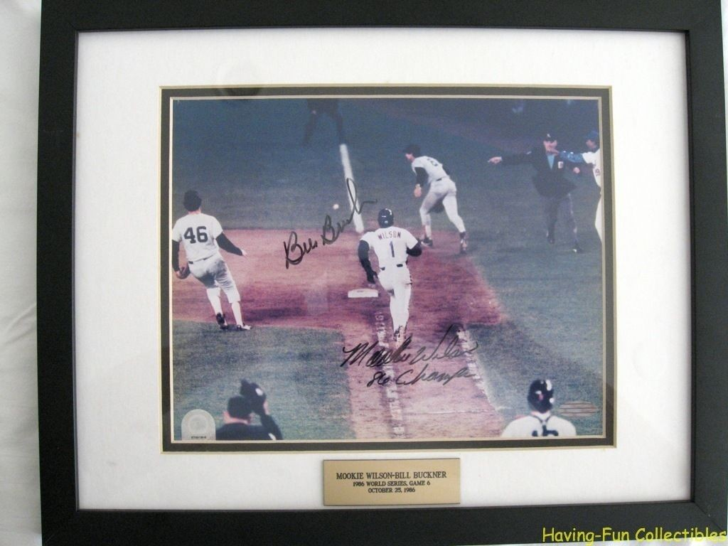 """Off the angle and spin"" as Mookie Wilson charges to first base after the balls rolls through Bill Buckner's lets. Autographs certified by Steiner Sports!"